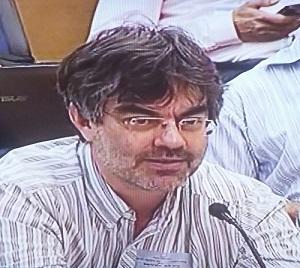 """עו""""ד גלעד ברנע בדיון ועדת הכלכלה על סעיף 52. קרדיט: ערוץ הכנסת"""